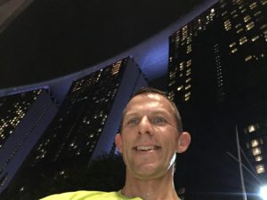 Axel running in Singapore in front of the Marina Bay Sands Hotel