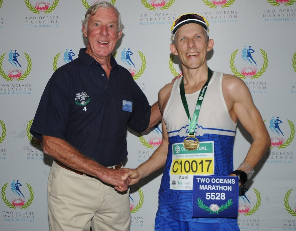 Axel receiving his blue number 5528 at the 2018 Two Oceans Ultra Marathon